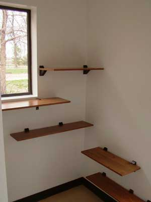 many shelves to lay on and windows to look out of